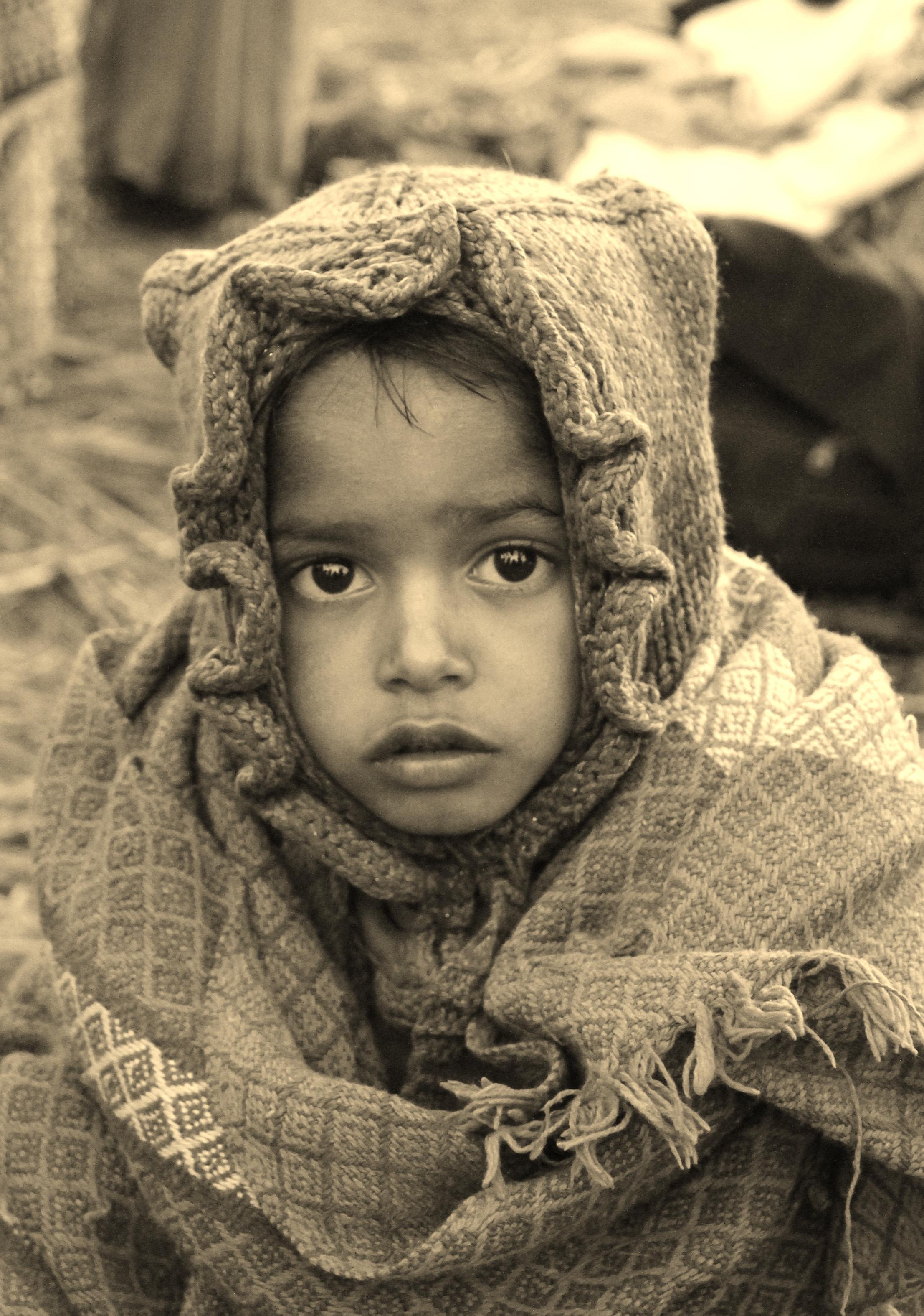 Kumbh Mela India - child wrapped up after early morning dunking
