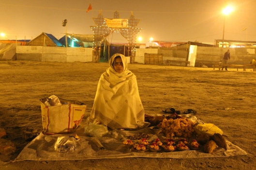 Kumbh Mela India - woman selling religious offerings